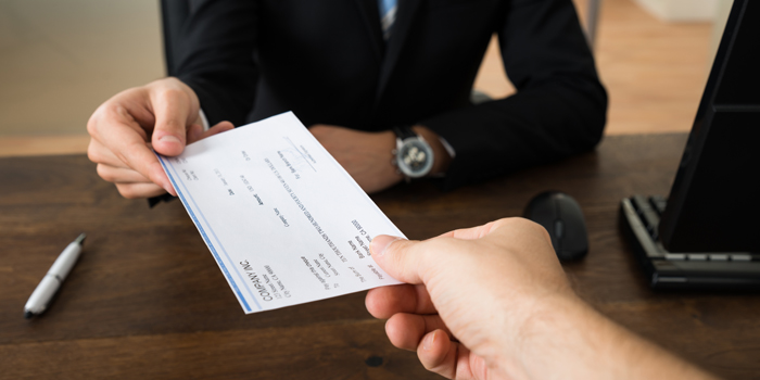 Person is receiving a check.