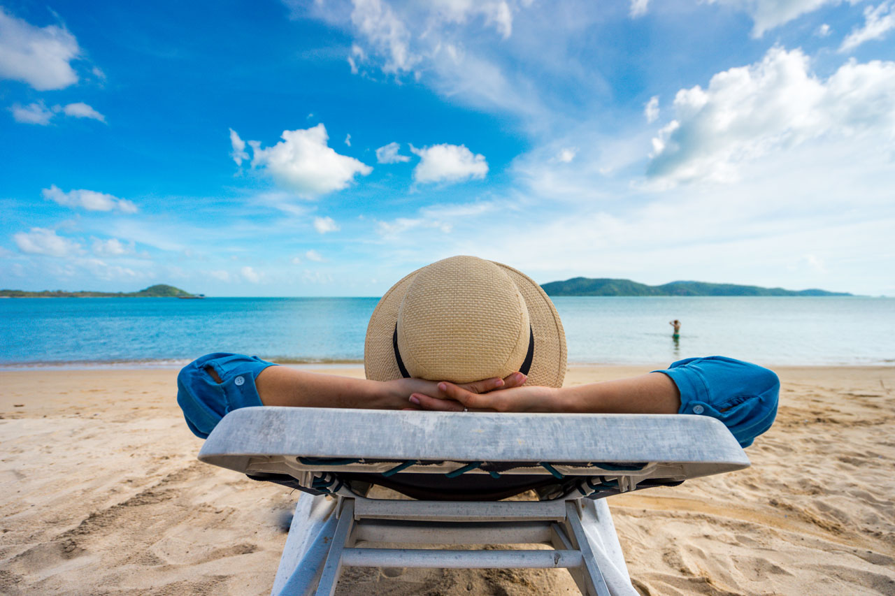 Young woman relaxing on beach, ocean view, Vacation Outdoors Seascape Concept