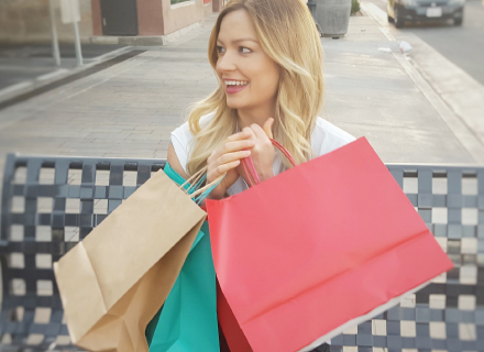college student holding shopping bags