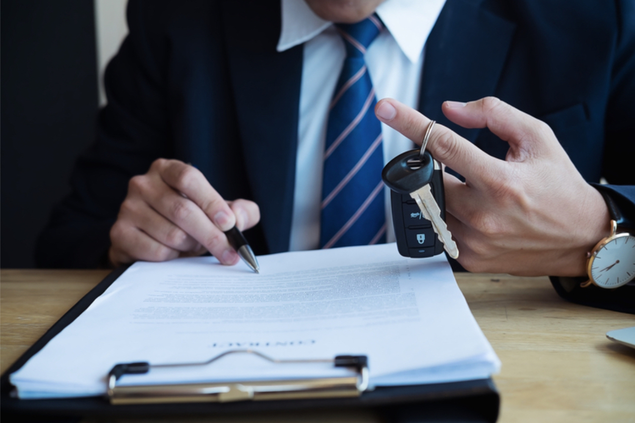 Car sales person reading the contract